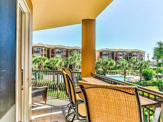 New listing! Vibrant condo w/ wraparound balcony, shared pool, & beach access