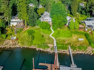 Stunning riverfront home w/ spacious deck, grill, two kitchens, & private dock!