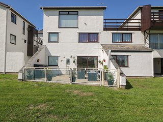 TY TRAETH, open plan accommodation, all ground floor, garden with patio, in