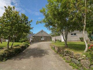 GLAN FELIN, pet friendly, wood burners, exposed beams, garden with stream, in