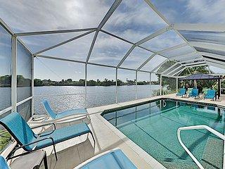 Large Waterfront House w/ Screened Lanai, Heated Pool, Bikes & Kayaks