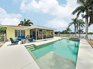 Canal-Front Getaway: Pool, Screened Lanai, Dock – Minutes to Beach & Dining!