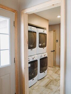 Main floor laundry area for guests at Esther Mountain Chalet.