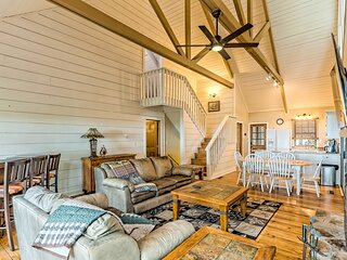 New listing! Secluded gem surrounded by trees w/ wraparound deck & shared pool