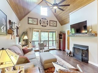 New listing! Take in the natural beauty from this elegant riverfront home