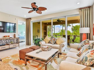 New listing! Bright & beachy condo w/ a furnished sunroom, shared pool, & grills