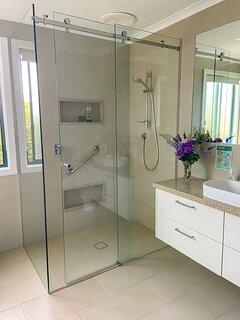 Double walk-in bathroom, vanity, toilet, large mirror