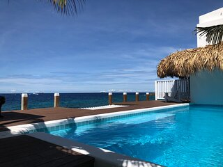 Private luxury Beach House Pietermaai on sunny Curacao, historic downtown area.