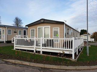 2 bed platinum Wrap decking bath en suite Haven caister pets welcome, location de vacances à Runham
