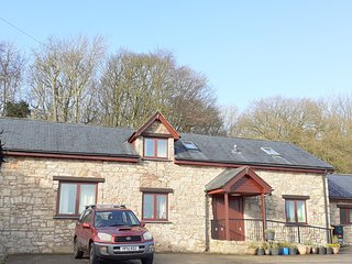 Henblas Holiday Cottages surrounded by woodland in beautiful North Wales