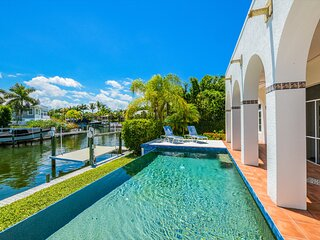 Welcome to Grande Palm, A Luxury Pool Home With Dock In Town Boca Grande