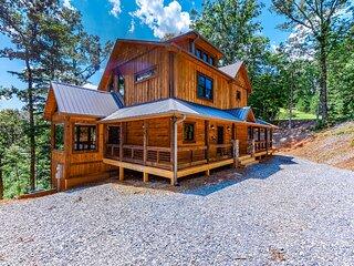 New listing! Gorgeous home w/ a wraparound deck, private hot tub, & full bar