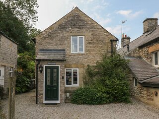 HOPE COTTAGE, en-suite, woodburning stove, enclosed garden, parking, in