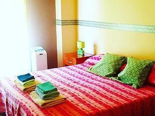 camera matrimoniale con letto aggiunto, vakantiewoning in Gallina