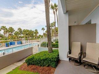 Charming coastal condo w/ hot tub, patio, & pool close to beach/ everything!