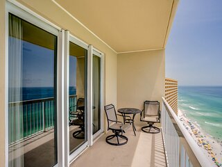 Cozy & colorful beachfront condo w/ a balcony, shared pools, & fitness center