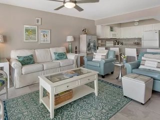 Beach chic condo steps to the beach! Close to shopping and dining!
