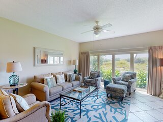 Beautiful beachfront home features private patio, & shared hot tub/ pool