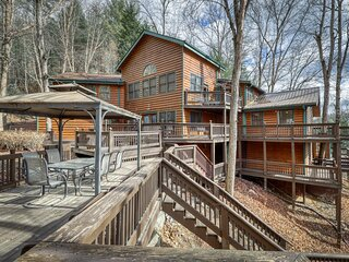Towering mountain home w/ a private hot tub, game room, & multiple decks