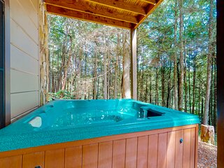 Waterfront, dog-friendly cabin next to trails w/ private hot tub & foosball!