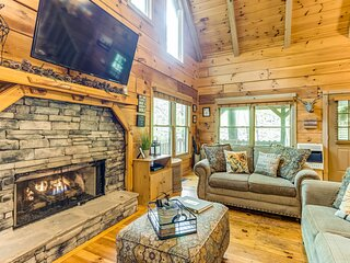 Dog-friendly woodland cabin features private hot tub, foosball, & fire pit!