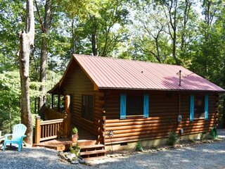 Lakefront cabin in the woods w/ a dock, private hot tub, & furnished balcony