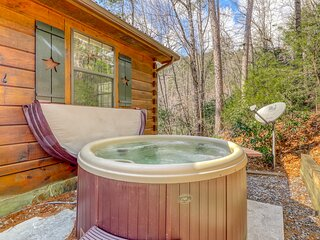 Adorable, dog-friendly cabin w/ a private hot tub, furnished deck, & forest view