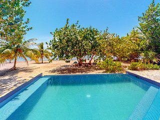 Oceanfront home w/ private pool, beach & rooftop deck - enjoy partial AC & WiFi!