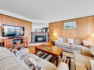 Coastal condo w/ partial ocean views, shared sauna, & fireplace!