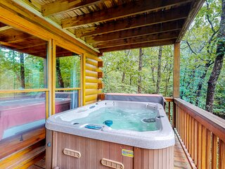 Dog-friendly mountain cabin w/ a private hot tub, furnished deck, & fish ponds!