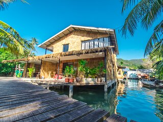 Stilt house between sea and river