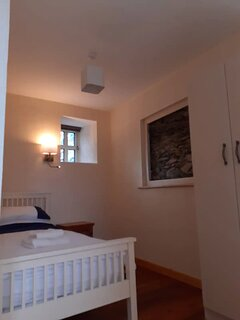 Downstairs bedroom no3. Containing a single bed.