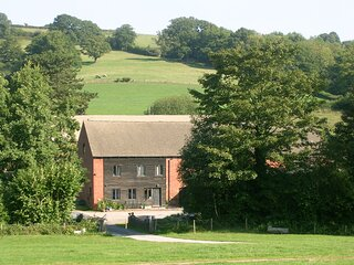 Idyllic countryside barn retreat, with games room.