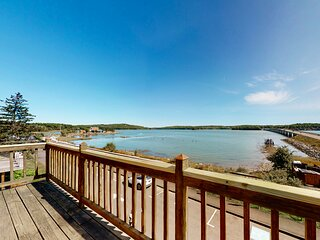Riverfront condo w/ deck overlooking the water - steps to dining & shopping!