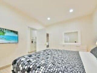 Exquisite & Modern Home w/ AC, Parking, & 4K TVs