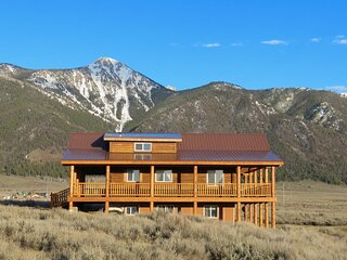 Sheep Mountain towers over the cabin
