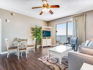Waterfront condo w/ private balcony, shared pool, fitness center, & beach access