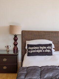 Upstairs en-suite bedroom with king bed