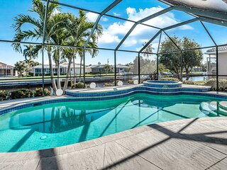 Dog-friendly family getaway w/ private pool/hot tub, lanai, & canal views!