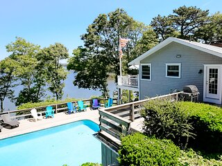 Dog-friendly, waterfront home w/ a beach, private pool, central A/C, & kayaks