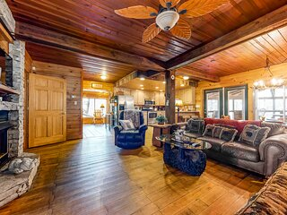 Cozy Riverfront Cabin w/ a Private Hot Tub, Free WiFi, Furnished Deck, & Firepit