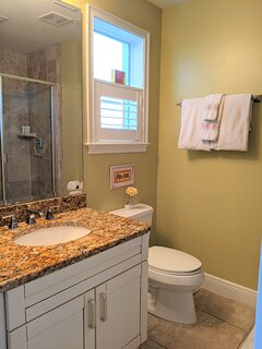 3rd bathroom with shower stall.