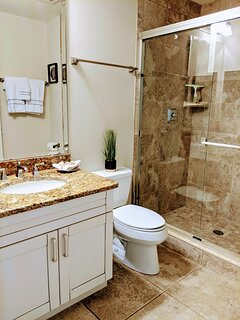 Second full bathroom with large walk-in shower.