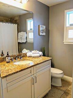 Master bathroom with bath tub.