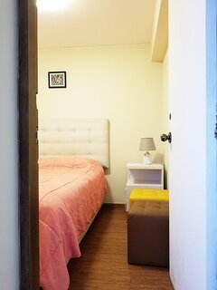 The third bedroom is small and has a double bed