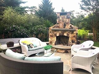 Warm up Fireside or in the Hot Tub at this Luxurious Home