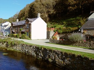 Mill Cottage, lovely setting, with the Solva River to the fore. Private parking.