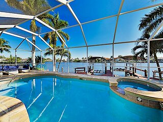 Waterfront Gem with Private Dock, Gulf Access, Heated Pool & Spa, Home Office