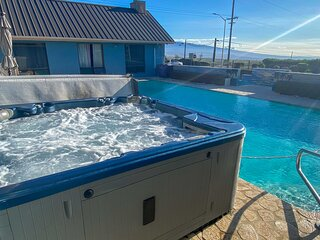 Soothe your muscles in the hot tub and enjoy the water feature.