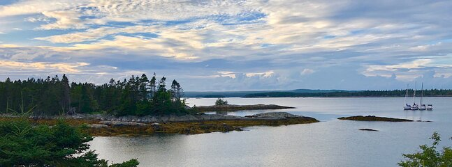 Our cove and bay in late afternoon. Sail boats frequent our waters in warmer months.